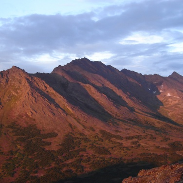 Sunset casts a glow on the Chugach Mountains near Anchorage Alaska