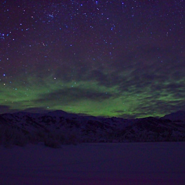 Northern Lights & stars over part of the Alaska Range